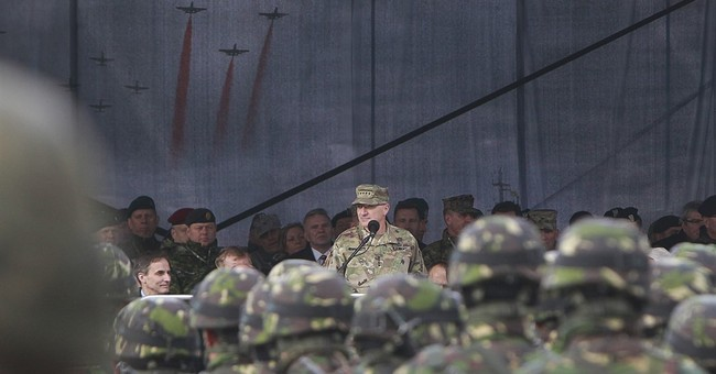 Polish leader welcomes NATO troops, hails 'historic moment'