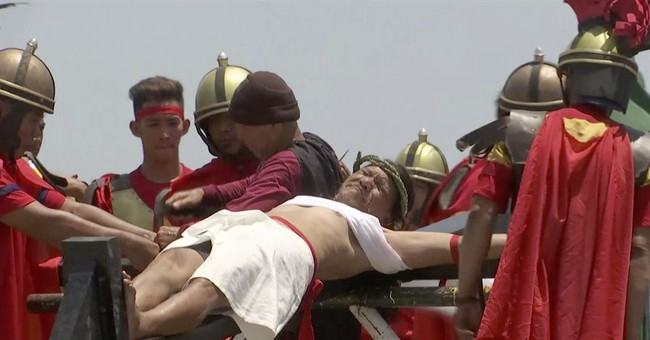 Filipinos re-enact Christ's crucifixion in gory spectacle
