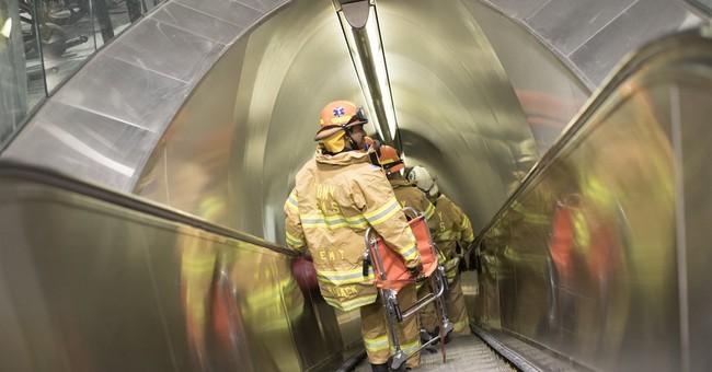 Train stuck in tunnel 3 hours, then stun gun sparks stampede