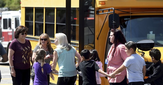 The Latest: Boy wounded in school shooting out of hospital