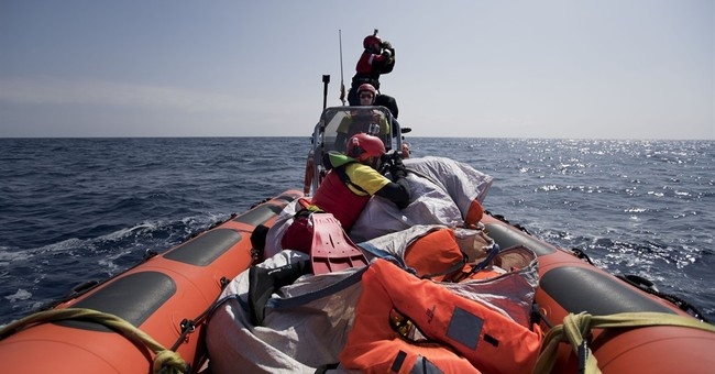 The Latest: Boat with 199 migrants stopped in Turkish waters