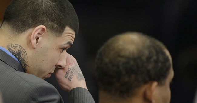 The Latest: Victims' kin 'devastated' by Hernandez acquittal