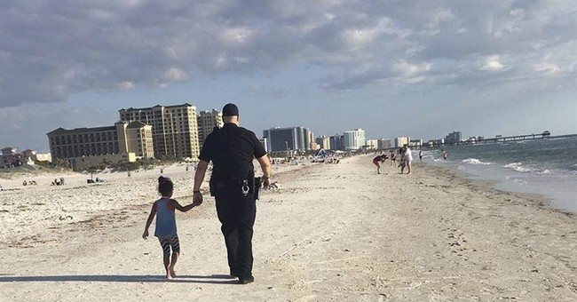Little girl lost: Officer guides crying child to family