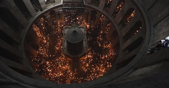 Holy fire ceremony in Jerusalem draws thousands