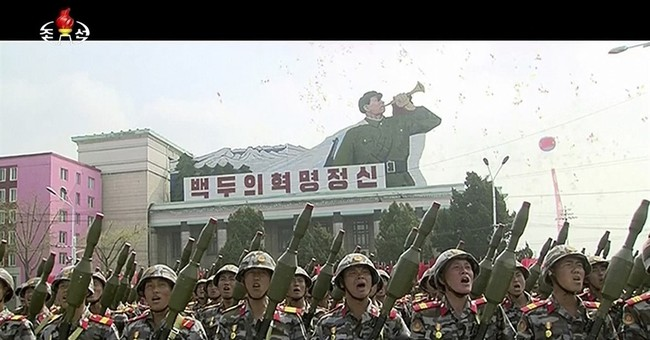 North Korea rolls out missiles, other weaponry at parade
