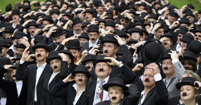 Hundreds dress up as Chaplin's 'Tramp' at star's Swiss home