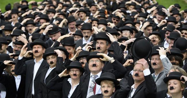 Hundreds dress up as Chaplin's 'Tramp' at star's Swiss home