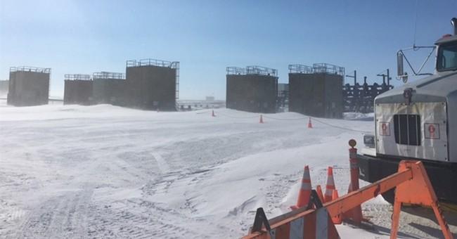 Workers relieve pressure on leaking Alaska oil well