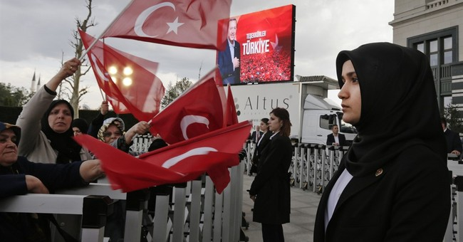 Turkey's president Erdogan fulfills ambition, but at a cost