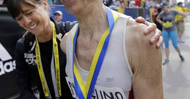 Kenyans sweep Boston Marathon on a good day for US runners
