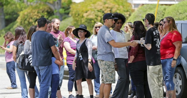 The Latest: School beginning to heal after shooting