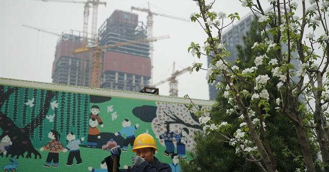 China's 1Q economic growth ticks higher to 6.9 percent