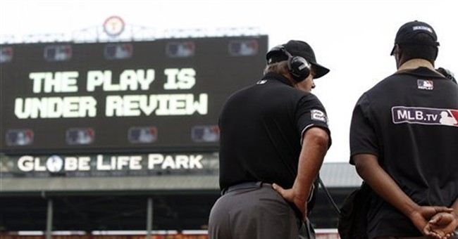 AP Exclusive: Umps may soon take to mic to explain replays