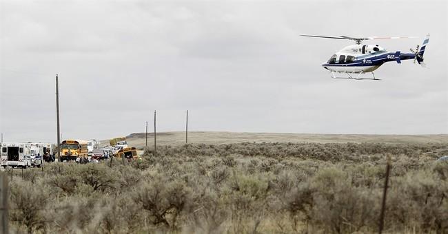 The Latest: Police identify Idaho rollover bus crash cause