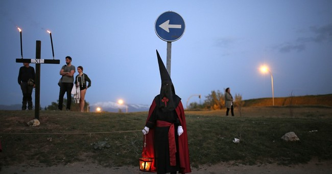 AP PHOTOS: Hooded penitents celebrate Easter in Spain