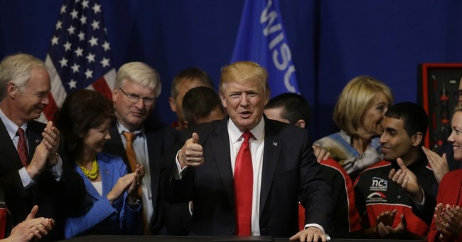 AP FACT CHECK: Trump ignores 100-day high achievers