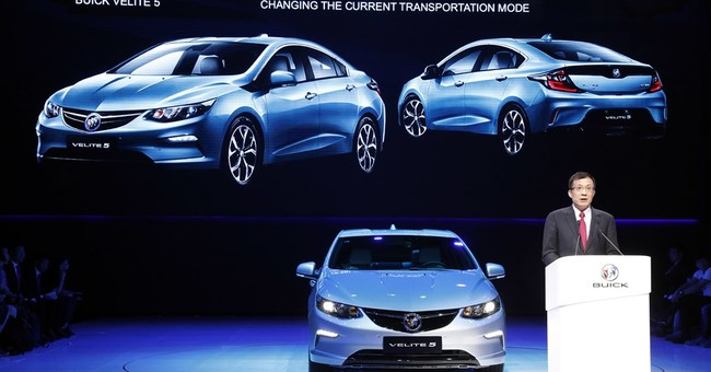 The Latest: Ford unveils 1st gasoline-electric hybrid