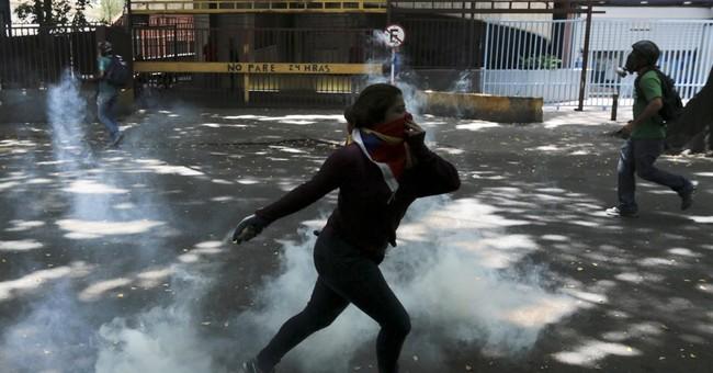 2 killed amid massive anti-government marches in Venezuela