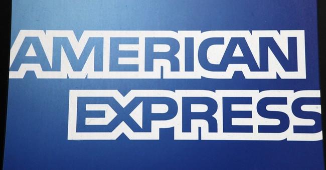 American Express profit falls 13 percent, but tops forecasts