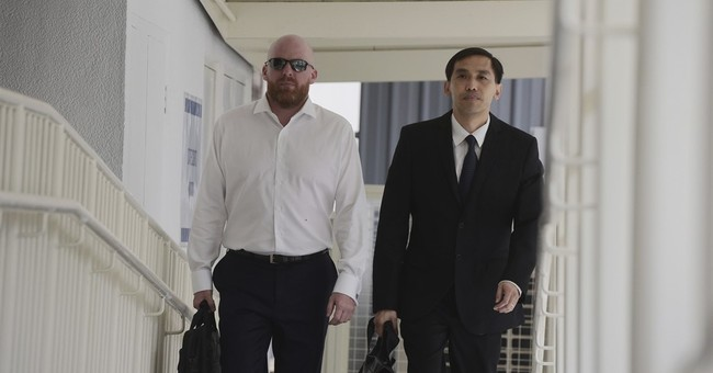 Singapore jails, fines Swiss bank's ex-manager in 1MDB case