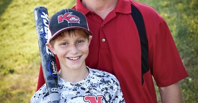 Family of boy killed on Kansas waterslide settles with park