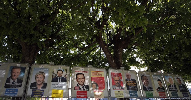 French vote in most unpredictable contest in generations