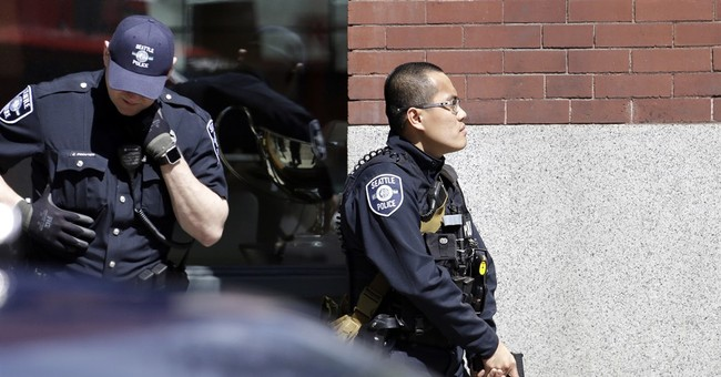 3 Seattle officers shot; 1 suspect dead, 2 in custody