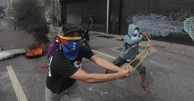 The Latest: US reviews case that led Venezuela to seize GM