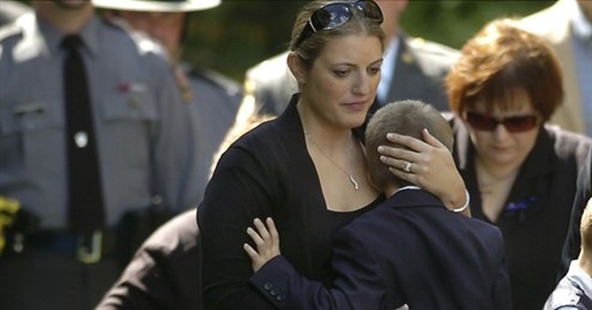 The Latest: Slain trooper's widow tells of devastated family