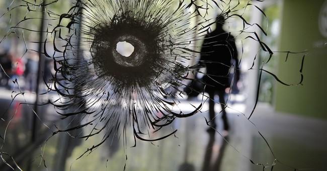 Champs-Elysees gunman had long criminal record, praised IS