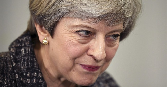 UK'S May promises to keep 0.7 percent foreign aid commitment