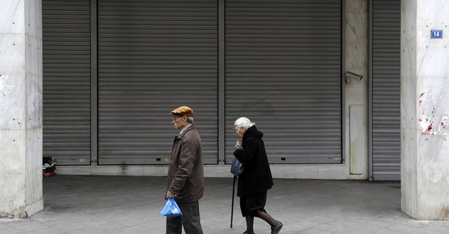 Greece beats a key bailout target but faces hard choices