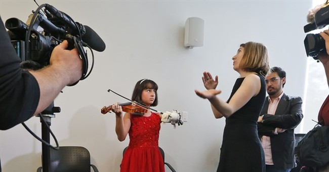Prosthetic arm designed by undergrads lets girl play violin