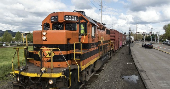 Police: Woman distracted by phone hit by train, badly hurt