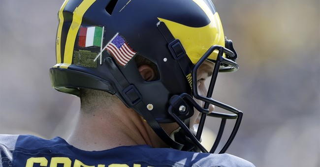 Addio! Michigan's football team heads to Italy