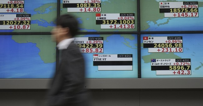Global stocks mixed ahead of French vote