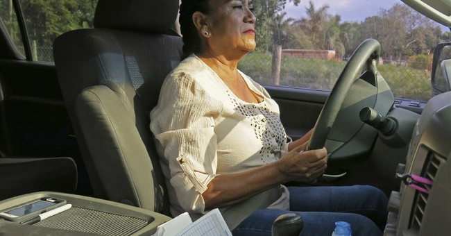 1 woman's protest: Free rides to immigrants without licenses