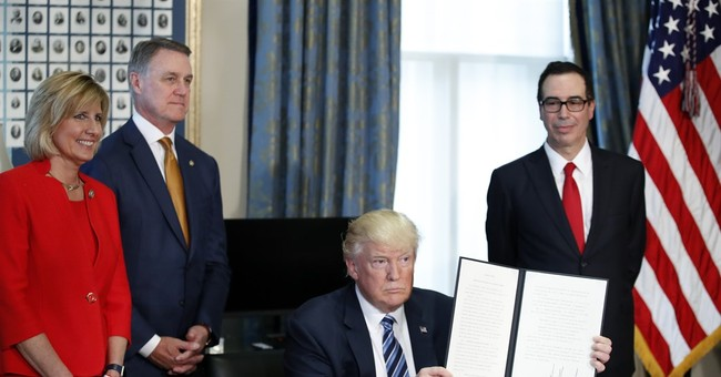 Trump eyes changes to Obama's tax and Wall Street rules