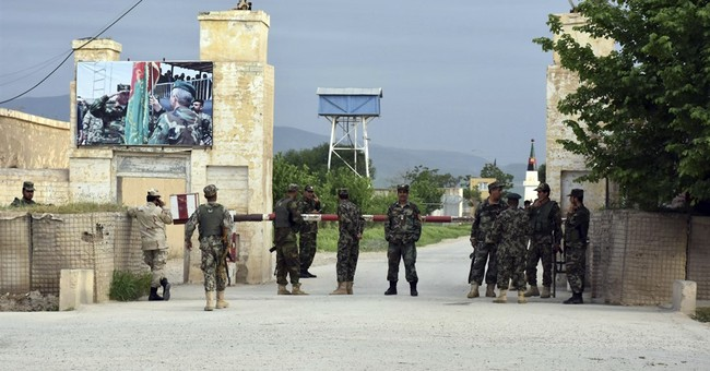 Afghan defence minister and army chief quit after Taliban slaughter