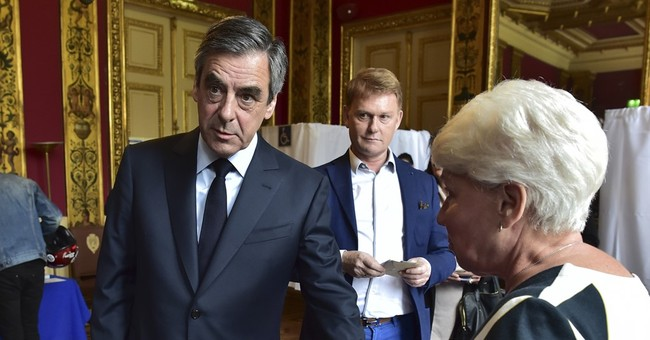 Tight, tense French presidential vote echoes around world