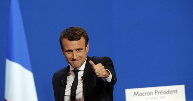 French stocks soar to near-decade highs as Macron tops poll