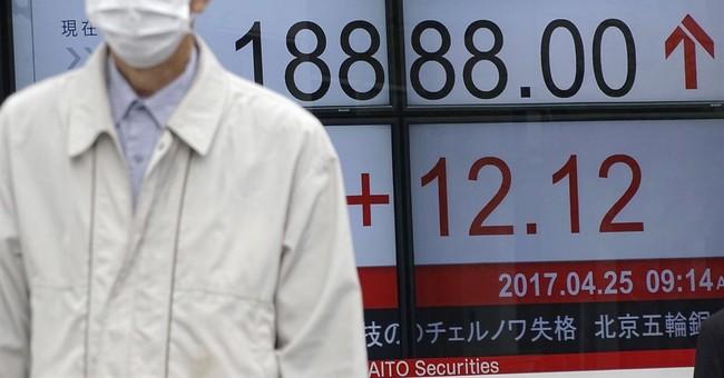 Asia tracks French election rally; weak yen lifts Tokyo