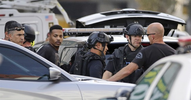 Man who shot at car in downtown Los Angeles surrenders