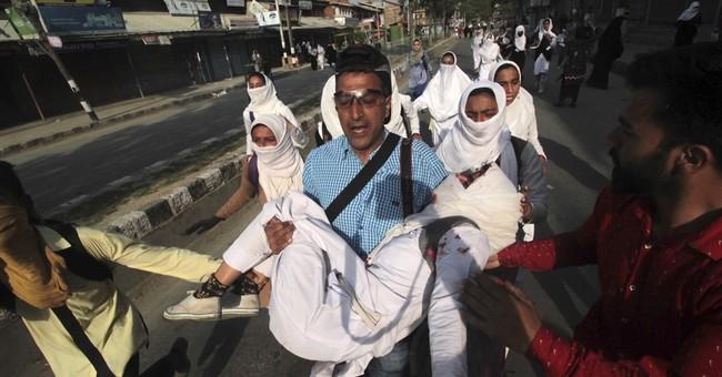 AP journalist covering Kashmir protest helps injured teen