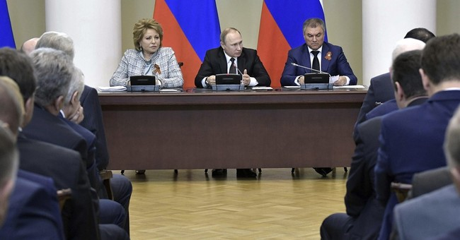 Putin criticizes opponents' corruption fight in Russia