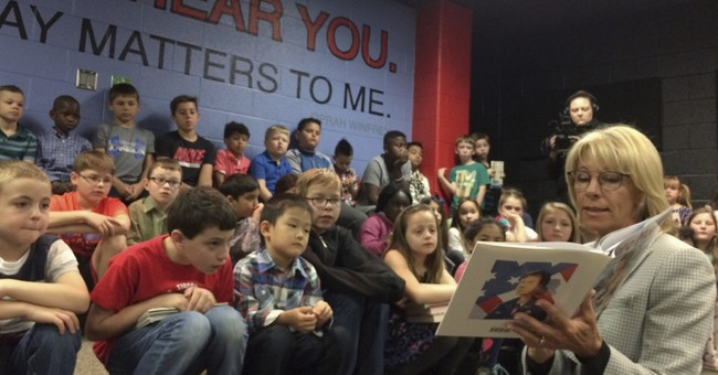 DeVos tours Virginia school to stress needs of military kids