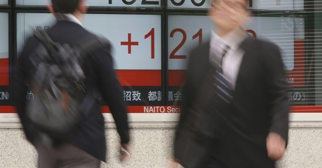 Global stocks mixed as investors await Trump tax cut plan