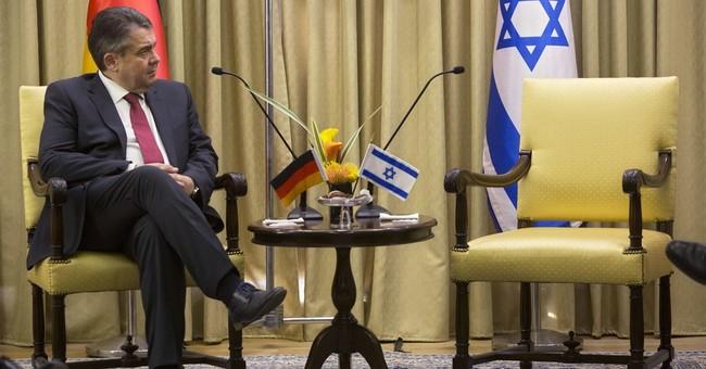 Merkel spokesman backs German minister in Israel visit spat