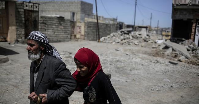 Iraqi troops capture largest neighborhood in western Mosul