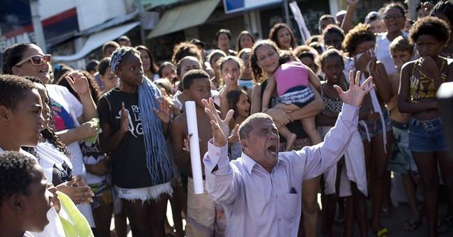 Rio slum dwellers protest deadly gang, police gunbattles